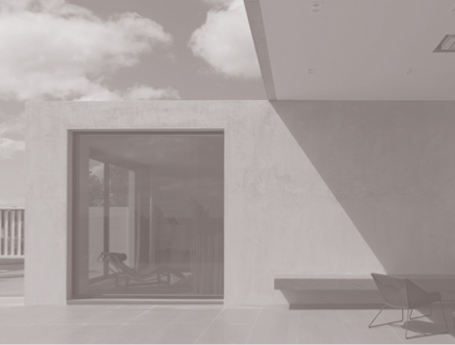 The minimalist exterior of Casper's Kooyong House, with powdered concrete beautifully absorbing the light of a sunny day.